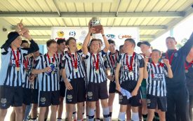 City u15's raise the Cup aloft after winning yesterday's final