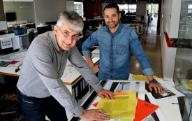 Studio Nine Architects' John Gallucio and Andrew Steele work on plans for the new artificial pitch