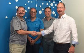 italktravel Glynde Managing Director Mark Carosi (left) with fellow Directors Rick Pirone and John Longo, cement the Partnership with Adelaide City's Commercial Manager Marcus Lacey